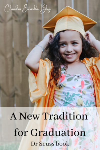 small girl in cap and gown, graduation from kinder