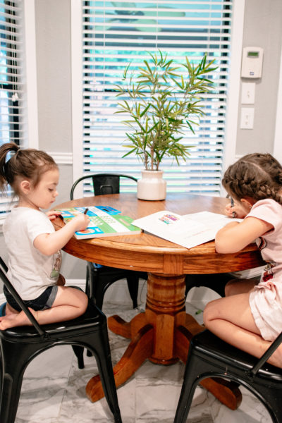 sisters reading on a table